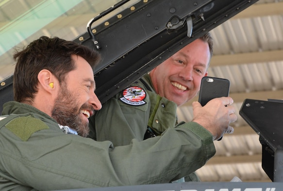 Actor Hugh Jackman introduces Lt. Col. David Efferson, the 457th Fighter Squadron commander and F-16 Fighting Falcon pilot, to his wife over the phone Feb. 19, 2016, during flight preparations at Naval Air Station Joint Reserve Base Fort Worth, Texas. Jackman received a civic leader flight in an F-16 by the 301st Fighter Wing, an Air Force Reserve unit. (U.S. Air Force photo/Staff Sgt. Samantha Mathison)