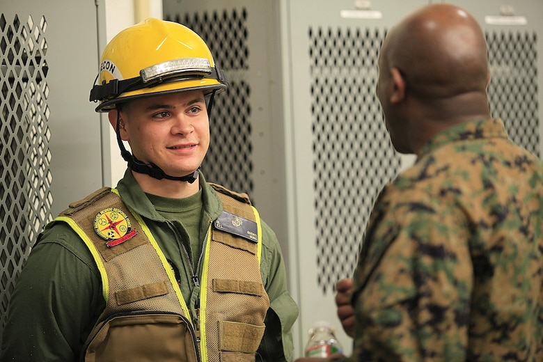 Cedar City, Utah- native Cpl. Sawyer L. Guerin, a non ambulatory decontamination Marine with Decontamination Platoon, React Force Company, Chemical Biological Incident Response Force (CBIRF), listens to Sgt. Maj. Ronald L. Green, the 18th Sergeant Major of the Marine Corps, during an Initial Response Force static display in the battalion assembly room at CBIRF Headquarters, Naval Support Facility Indian Head, Feb. 18, 2016. Green visited the Marines, sailors and civilians with CBIRF at Naval Support Facility Indian Head and Raymond M. Downey Responder Training Facility. During Green's visit, he received a CBIRF brief given by the CBIRF Commanding Officer, Col. Stephen E. Redifer, viewed a static display of an Initial Response Force set-up, talked to CBIRF personnel, toured the Downey Responder Training Facility and had lunch with CBIRF staff noncommissioned officers.  When directed, CBIRF forward-deploys and/or responds with minimal warning to a chemical, biological, radiological, nuclear or high-yield explosive (CBRNE) threat or event in order to assist local, state, or federal agencies and the geographic combatant commanders in the conduct of CBRNE response or consequence management operations, providing capabilities for command and control; agent detection and identification; search, rescue, and decontamination; and emergency medical care for contaminated personnel. (Official USMC Photo by Sgt. Santiago G. Colon Jr./RELEASED)