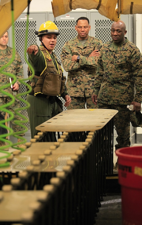 Miami, Fla.- native Sgt. David O. Ortiz, a team leader with Decontamination Platoon, React Force Company, Chemical Biological Incident Response Force (CBIRF), explains the procedures for the non-ambulatory casualty decontamination line to Sgt. Maj. Ronald L. Green, the 18th Sergeant Major of the Marine Corps, during an Initial Response Force static display in the battalion assembly room at CBIRF Headquarters, Naval Support Facility Indian Head, Feb. 18, 2016. Green visited the Marines, sailors and civilians with CBIRF at Naval Support Facility Indian Head and Raymond M. Downey Responder Training Facility. During Green's visit, he received a CBIRF brief given by the CBIRF Commanding Officer, Col. Stephen E. Redifer, viewed a static display of an Initial Response Force set-up, talked to CBIRF personnel, toured the Downey Responder Training Facility and had lunch with CBIRF staff noncommissioned officers.  When directed, CBIRF forward-deploys and/or responds with minimal warning to a chemical, biological, radiological, nuclear or high-yield explosive (CBRNE) threat or event in order to assist local, state, or federal agencies and the geographic combatant commanders in the conduct of CBRNE response or consequence management operations, providing capabilities for command and control; agent detection and identification; search, rescue, and decontamination; and emergency medical care for contaminated personnel. (Official USMC Photo by Sgt. Santiago G. Colon Jr./RELEASED)