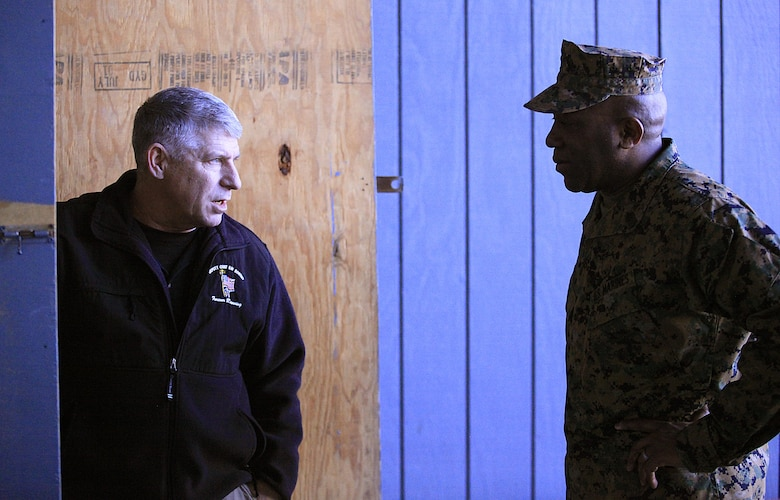 Retired Marine Master Sgt. Patrick Higgins,left, lead instructor at Raymond M. Downey Responder Training Facility guides Sgt. Maj. Ronald L. Green, the 18th Sergeant Major of the Marine Corps, through a tour of the facility where every Chemical Biological Incident Response Force (CBIRF) Marine trains to respond to Chemical, Biological, Radiological, Nuclear and High-Yield Explosives (CBRNE) incidents, Feb. 18, 2016. Downey Responder Training Facility is located at Naval Annex Stump Neck, Md.  Green visited the Marines, sailors and civilians with CBIRF at Naval Support Facility Indian Head and Downey Responder Training Facility. During Green's visit, he received a CBIRF brief given by the CBIRF Commanding Officer, Col. Stephen E. Redifer, viewed a static display of an Initial Response Force set-up, talked to CBIRF personnel, toured the Downey Responder Training Facility and had lunch with CBIRF staff noncommissioned officers.  When directed, CBIRF forward-deploys and/or responds with minimal warning to a chemical, biological, radiological, nuclear or high-yield explosive (CBRNE) threat or event in order to assist local, state, or federal agencies and the geographic combatant commanders in the conduct of CBRNE response or consequence management operations, providing capabilities for command and control; agent detection and identification; search, rescue, and decontamination; and emergency medical care for contaminated personnel. (Official USMC Photo by Sgt. Santiago G. Colon Jr./RELEASED)