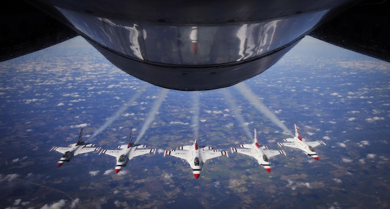 """The U.S. Air Force Air Demonstration Squadron """"Thunderbirds"""" fly the Delta formation over Louisiana Feb. 19, 2016. The Thunderbirds were refueled twice by a KC-135 Stratotanker from MacDill Air Force Base, Fla., once over New Mexico and a second time over Louisiana on their way to Daytona Beach, Fla., for their Daytona 500 flyover. (U.S. Air Force photo by Senior Airman Ned T. Johnston)"""