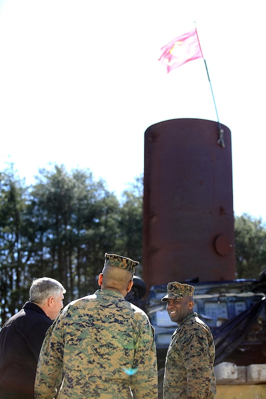 Sgt. Maj. Ronald L. Green, the 18th Sergeant Major of the Marine Corps, takes a look at pile of wrecked vehicles and debris used for technical rescue training at Raymond M. Downey Responder Training Facility, Naval Annex Stump Head, Md., Feb. 18, 2016. Green visited the Marines, sailors and civilians with Chemical Biological Incident Response Force (CBIRF) at Naval Support Facility Indian Head and Downey Responder Training Facility. During Green's visit, he received a CBIRF brief given by the CBIRF Commanding Officer, Col. Stephen E. Redifer, viewed a static display of an Initial Response Force set-up, talked to CBIRF personnel, toured the Downey Responder Training Facility and had lunch with CBIRF staff noncommissioned officers.  When directed, CBIRF forward-deploys and/or responds with minimal warning to a chemical, biological, radiological, nuclear or high-yield explosive (CBRNE) threat or event in order to assist local, state, or federal agencies and the geographic combatant commanders in the conduct of CBRNE response or consequence management operations, providing capabilities for command and control; agent detection and identification; search, rescue, and decontamination; and emergency medical care for contaminated personnel. (Official USMC Photo by Sgt. Santiago G. Colon Jr./RELEASED)