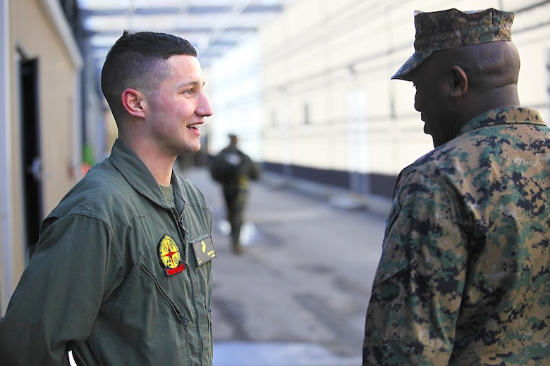 Manhattan, Kan. - native Lance Cpl. Gunnar I. Naughton, a team member with Identification Platoon, React Force Company, Chemical Biological Incident Response Force (CBIRF), listens to Sgt. Maj. Ronald L. Green, the 18th Sergeant Major of the Marine Corps, during Green's tour of Raymond M. Downey Responder Training Facility, Naval Annex Stump Head, Md., Feb. 18, 2016. Green visited the Marines, sailors and civilians with CBIRF at Naval Support Facility Indian Head and Raymond M. Downey Responder Training Facility. During Green's visit, he received a CBIRF brief given by the CBIRF Commanding Officer, Col. Stephen E. Redifer, viewed a static display of an Initial Response Force set-up, talked to CBIRF personnel, toured the Downey Responder Training Facility and had lunch with CBIRF staff noncommissioned officers.  When directed, CBIRF forward-deploys and/or responds with minimal warning to a chemical, biological, radiological, nuclear or high-yield explosive (CBRNE) threat or event in order to assist local, state, or federal agencies and the geographic combatant commanders in the conduct of CBRNE response or consequence management operations, providing capabilities for command and control; agent detection and identification; search, rescue, and decontamination; and emergency medical care for contaminated personnel. (Official USMC Photo by Sgt. Santiago G. Colon Jr./RELEASED)
