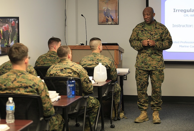 Sgt. Maj. Ronald L. Green, the 18th Sergeant Major of the Marine Corps, speaks to Chemical Biological Incident Response Force (CBIRF) Corporals Course participants during Green's tour of Raymond M. Downey Responder Training Facility, Naval Annex Stump Head, Md., Feb. 18, 2016. Green visited the Marines, sailors and civilians with CBIRF at Naval Support Facility Indian Head and Raymond M. Downey Responder Training Facility. During Green's visit, he received a CBIRF brief given by the CBIRF Commanding Officer, Col. Stephen E. Redifer, viewed a static display of an Initial Response Force set-up, talked to CBIRF personnel, toured the Downey Responder Training Facility and had lunch with CBIRF staff noncommissioned officers.  When directed, CBIRF forward-deploys and/or responds with minimal warning to a chemical, biological, radiological, nuclear or high-yield explosive (CBRNE) threat or event in order to assist local, state, or federal agencies and the geographic combatant commanders in the conduct of CBRNE response or consequence management operations, providing capabilities for command and control; agent detection and identification; search, rescue, and decontamination; and emergency medical care for contaminated personnel. (Official USMC Photo by Sgt. Santiago G. Colon Jr./RELEASED)