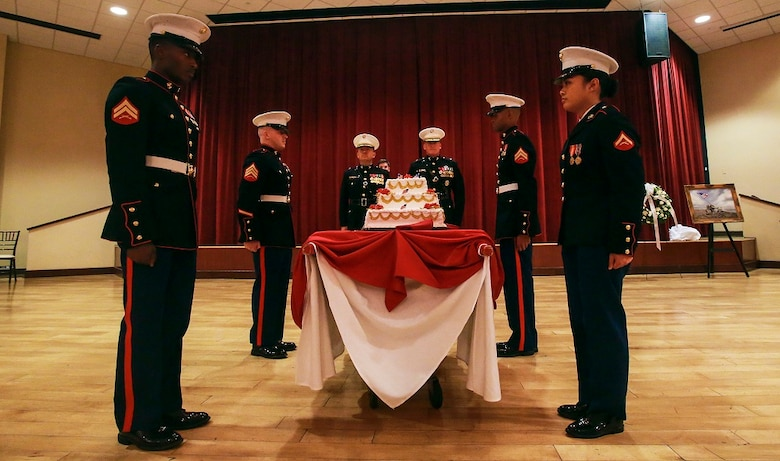 A detail of Marines presents a cake during the memorial dinner for the 71st anniversary of the Battle of Iwo Jima, Feb. 20 at Camp Pendleton. During the 36-day battle for the 8.5 square-mile island, 6,821 Marines gave their lives to gain control of the strategic position in the Pacific during World War II. The Marines in the cake detail are with Marine Corps Air Station Camp Pendleton. (U.S. Marine Corps photo by Lance Cpl. Caitlin Bevel)