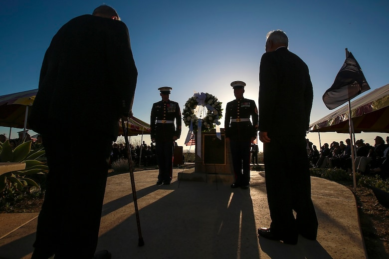 A detail including two active duty Marines and two veterans who served in the 5th Marine Division present a wreath during the 71st anniversary sunset memorial for the Battle of Iwo Jima, Feb. 20 at Camp Pendleton, Calif. During the 36-day battle for the 8.5 square-mile island, 6,821 Marines gave their lives to gain control of the strategic position in the Pacific during World War II. (U.S. Marine Corps photo by Lance Cpl. Caitlin Bevel)