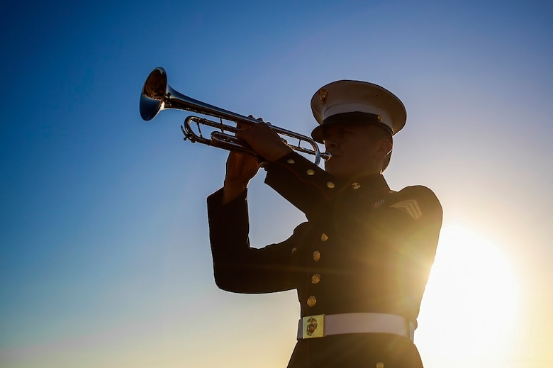 Sgt. Gregg Alvarez plays Taps during the sunset memorial for the 71st anniversary of the Battle of Iwo Jima, Feb. 20 at Camp Pendleton, Calif. During the 36-day battle for the 8.5 square-mile island, 6,821 Marines gave their lives to gain control of the strategic position in the Pacific during World War II. Alvarez, from Harlingen, Texas, is a musician with the 1st Marine Division Band, I Marine Expeditionary Force. (U.S. Marine Corps photo by Lance Cpl. Caitlin Bevel)