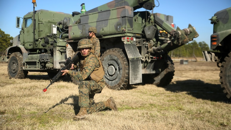 Lance Cpl. Brandon C. Waples, the recovery team leader with Combat Logistics Battalion 6, provides security for an MK36 Wrecker crew during a convoy operations exercise at Camp Lejeune, N.C., Feb. 11, 2016. The Marines encountered opposing forces during the convoy and faced both small arms and indirect fire. (Official Marine Corps photo by Cpl. Joey Mendez/Released)