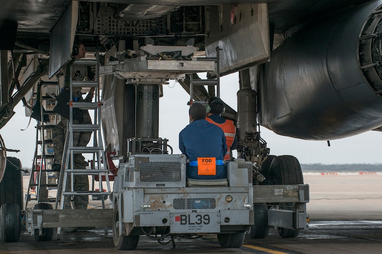 A weapons load crew assigned to the 489th Maintenance Squadron, prepares to download a Joint Air-to-Surface Standoff Weapon from the bomb bay of a B-1 Lancer during an exercise on Feb. 21, 2016, Dyess Air Force Base, Texas. Members of the Air Force Reserve Command's 489th Bomb Group participated in the exercise alongside their Active Duty counterparts from the 7th Maintenance Squadron. (U.S. Air Force photo by Master Sgt. Greg Steele/Released)
