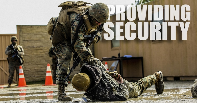 Marines with Bravo Company, 2nd Law Enforcement Battalion, subdue role players after a notional altercations at a forward observation base during an interior guard training exercise at Forward Observation Base Hawk at Camp Lejeune, N.C., Feb. 17, 2016. The training prepared Marines to conduct real-life site security operations. (U.S. Marine Corps illustration by Lance Cpl. Erick Galera/Released)