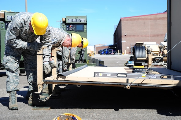 Members of the 315th Airlift Control Flight construct a hardside expandable light air mobility shelter during training exercise Patriot Sands Feb. 17, 2016, at Hunter Army Airfield, Ga. (U.S. Air Force Photo/Senior Airman Jonathan Lane)