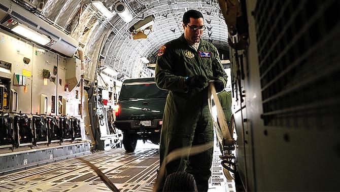Senior Airman Christiane Rowman, 315th Airlift Control Flight loadmaster, straps down equipment in a C-17 Globemaster III during training exercise Patriot Sands Feb. 17, 2016, at Hunter Army Airfield, Georgia. (U.S. Air Force Photo by Senior Airman Jonathan Lane)