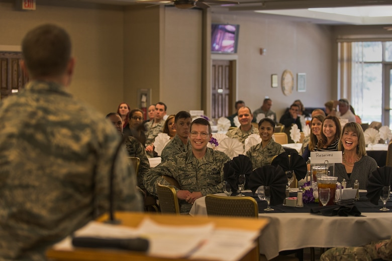 U.S Air Force Maj. Brandon Wengert, 23d Force Support Squadron commander, entertains the crowd with his presentation during the Key Spouses' luncheon, Feb. 18, 2016, at Moody Air Force Base, Ga. Moody leadership hosted the luncheon to show appreciation for Key Spouses and all they do for Moody's Airmen. (U.S. Air Force photo by Airman Daniel Snider/Released)
