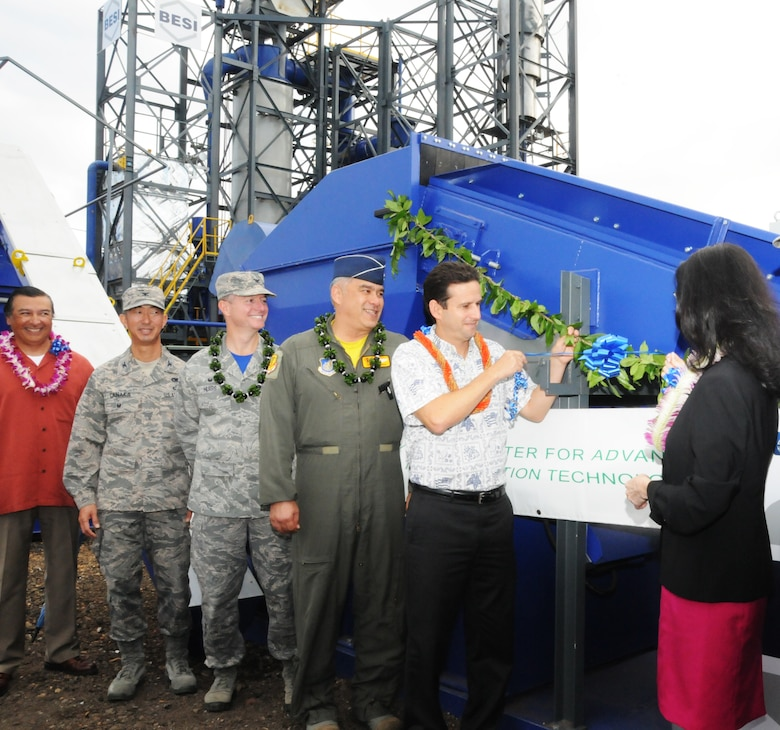 U.S. Senator Brian Schatz pulls the ribbon at the unveiling ceremony of a new $6.8 million waste to energy system at Joint Base Pearl Harbor-Hickam, Hawaii, Feb. 19, 2016.  The new system is one part of the Hawaii Air National Guard's renewable energy strategy. The Air Force Research Labs selected the Hawaii Air National Guard's 154th Wing to demonstrate an integrated microgrid concept that tests the viability of using renewable energy and microgrids to assure that the Air Force can continue mission critical operations regardless of the state of the public utility grid or cyber-attack. (U.S. Air National Guard photo by Senior Airman Orlando Corpuz/released)