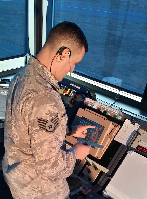 U.S. Air Force Staff Sgt. Jacob Burkhalter, Tower Watch Supervisor for the 235th Air Traffic Control Squadron, operates an Enhanced Terminal Voice Switch (ETVS) allowing quick access to pre-programed radio frequencies and telephone lines during daily operations, Feb 10, 2016. Burkhalter is able to monitor all frequencies and positions at the same time making his response quicker and more efficient in case of a miscommunication. Burkhalter, who was recently selected as 2015 Air Traffic Controller of the Year, provides air traffic control services for all civilian and military aircraft at Stanly County Airport, in New London, N.C. (U.S. Air National Guard photo by Tech. Sgt. Alex McCorkle/Released)