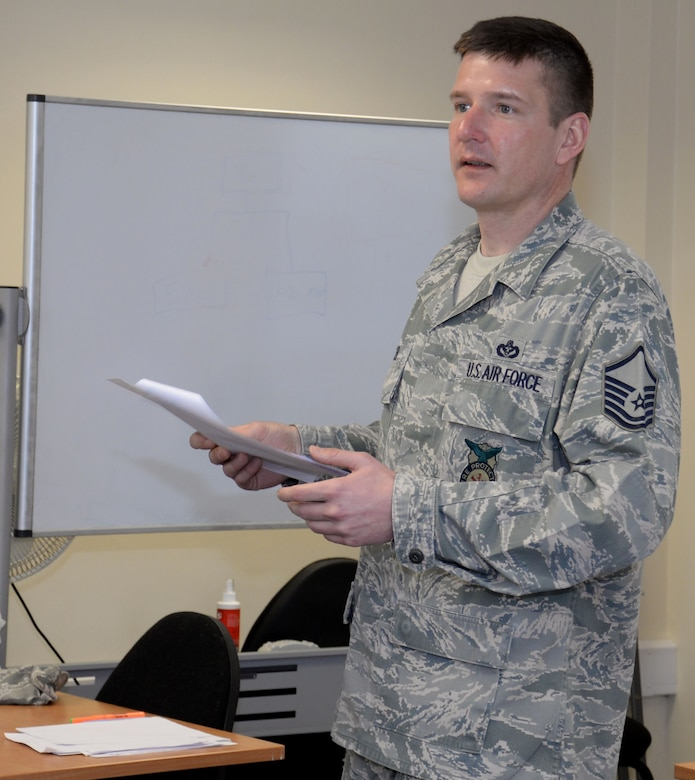 U.S. Air Force Master Sgt. Michael Wobser, 100th Civil Engineer Squadron Fire Department assistant chief of operations, goes through the results of a test during a National Incident Management System 300/400 course Feb. 18, 2016, on RAF Mildenhall, England. The topics in the class covered many areas of emergency management including initial response, resource management and planning. (U.S. Air Force photo by Gina Randall/Released)