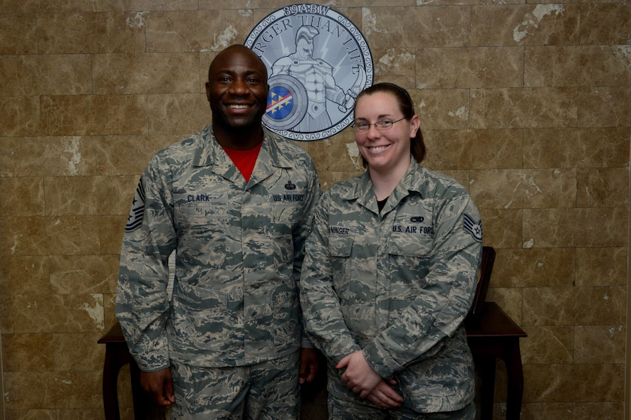 Chief Master Sgt. Vegas Clark, 39th Air Base Wing command chief, stands with Staff Sgt. Michele Waninger, 39th Maintenance Squadron aerospace ground equipment technician, in the 39th ABW conference room before beginning Waninger's chief shadow day Feb. 19, 2016. Airmen are chosen for the command chief's shadow program based on their commander's recommendation about their dedication to the mission and their job. (U.S. Air Force photo by Staff Sgt. Michael Battles)