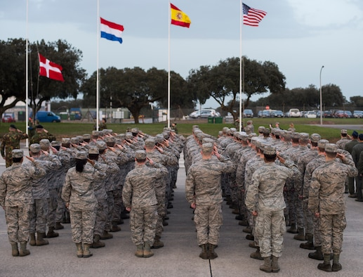 U.S. Airmen along with their international counterparts salute during the opening ceremony of exercise Real Thaw 16 in Beja, Portugal, Feb. 21, 2016. Real Thaw 16 is a Portuguese- hosted NATO exercise that provides tactical training to multiple participating nations. Its aim is to merge and employ different aerial platforms towards one major objective, covering a vast range of activities to include Defensive and Offensive Counter Air Operations, High Value Air Assets Protection and a Slow Mover Protection. Approximately 3,500 service members throughout Europe and the U.S. are participating in the event. (U.S. Air Force photo/Senior Airman Jonathan Stefanko)