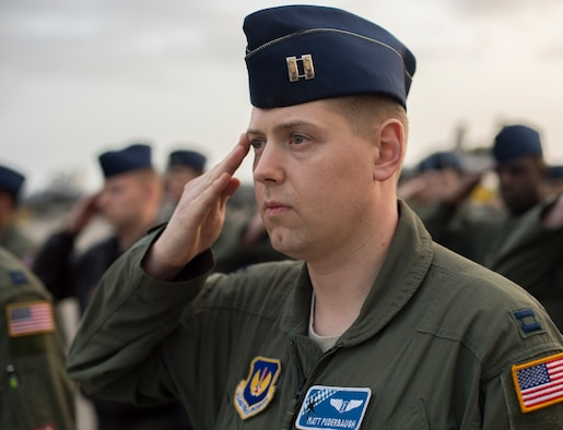 Capt. Matt Puderbaugh, 37th Airlift Squadron flight surgeon, salutes during the opening ceremony of exercise Real Thaw 16 in Beja, Portugal, Feb. 21. Real Thaw 16 is a Portuguese hosted NATO exercise that provides tactical training to multiple participating nations. Its aim is to merge and employ different aerial platforms towards one major objective, covering a vast range of activities to include Defensive and Offensive Counter Air Operations, High Value Air Assets Protection and a Slow Mover Protection. Nations participating this year include the U.S., Portugal, Belgium, Denmark, France, Netherlands, Norway and Spain. (U.S. Air Force photo/Senior Airman Jonathan Stefanko)