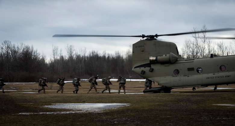 Soldiers from C Troop 2/101 Cavalry, from Buffalo, simulate breaking contact and boarding a U.S. Army CH-47 Chinook helicopter for extraction, Youngstown, NY, Feb. 20, 2016. The Soldiers are training in preparation for larger scale exercises to be held throughout the year. (U.S. Air National Guard photo by Staff Sgt. Ryan Campbell/Released)