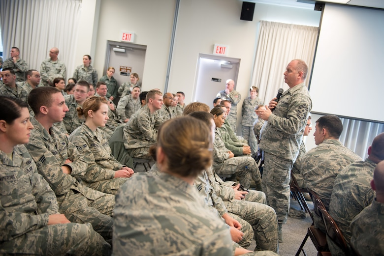 U.S. Air Force Chief Master Sgt. James Hotaling, command chief, Air National Guard, conducted a town hall meeting with enlisted members during his visit to Otis Air National Guard Base, Mass., Feb. 7, 2016. Hotaling discussed current issues facing the Air National Guard and answered questions from wing members. (U.S. Air National Guard photo by Tech. Sgt. Kerri Spero/Released)