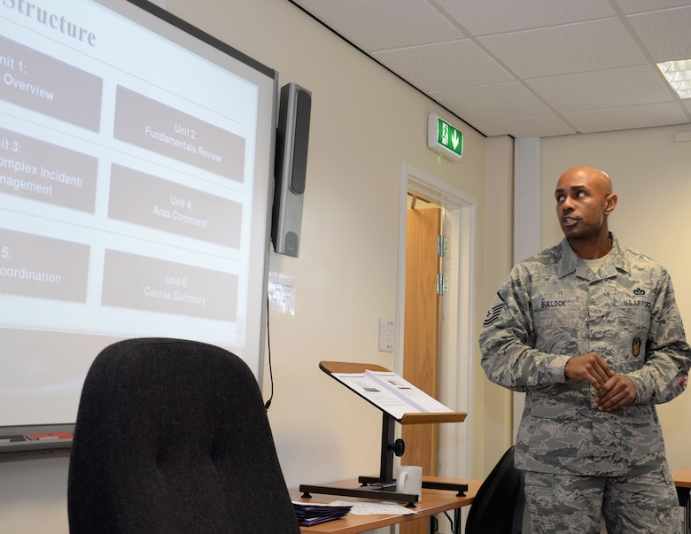 U.S. Air Force Master Sgt. Dion Bullock, 100th Air Refueling Wing readiness inspections superintendent, provides an outline of the National Incident Management System 300/400 course Feb. 18, 2016, on RAF Mildenhall, England. The training was intended for all personnel who are directly involved in emergency management and response. (U.S. Air Force photo by Gina Randall/Released)
