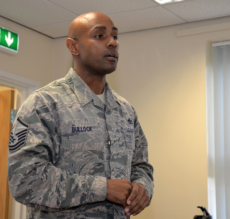 U.S. Air Force Master Sgt. Dion Bullock, 100th Air Refueling Wing readiness inspections superintendent, discusses the topics during a National Incident Management System 300/400 course Feb. 18, 2016, on RAF Mildenhall, England. This training was intended to aid people who don't usually work together, or even know each other, to seamlessly respond to and recover from a disaster, either natural or man-made. (U.S. Air Force photo by Gina Randall/Released)