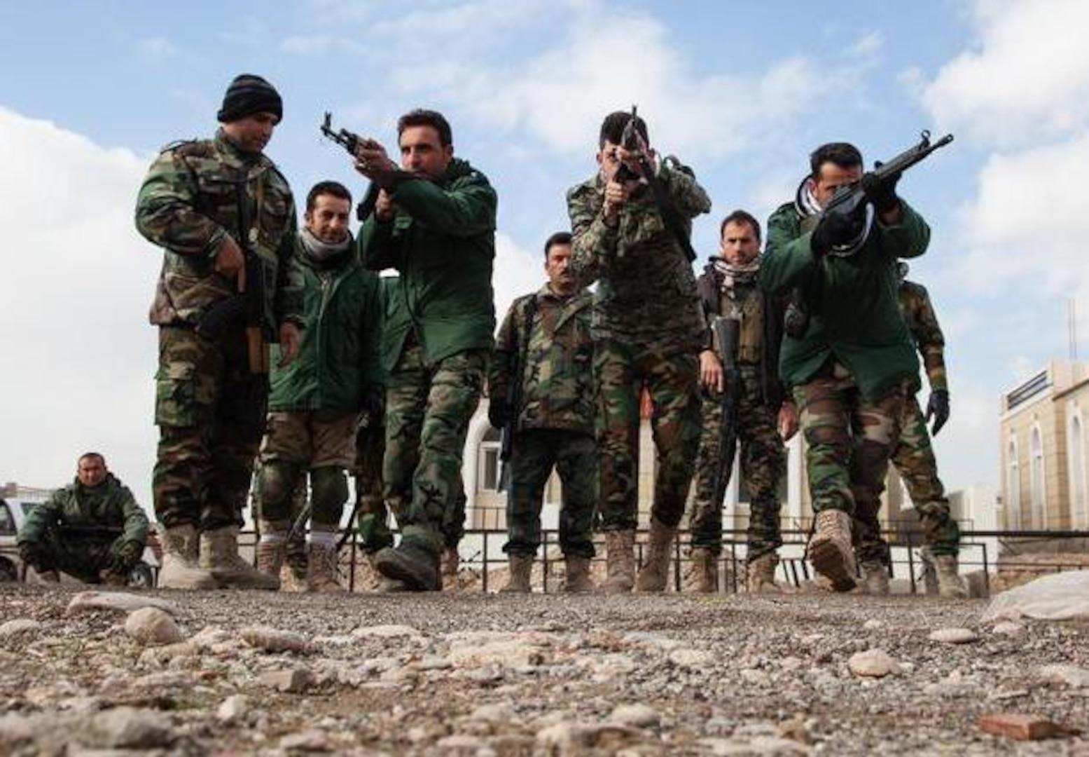 Peshmerga soldiers rehearse urban tactical movement at a training base near Irbil, Iraq, Jan. 26, 2016. (Army photo by Spc. Jessica Hurst)