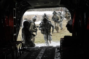 New York Army National Guard  Soldiers of Troop C, 2nd Squadron, 101st Cavalry  board a CH-47F Chinook helicopter flown by members of Company B, 3rd Battalion, 126th Aviation, during an insertion and extraction training mission Saturday, Feb. 20, 2016 at the Youngstown Local Training Area in Youngstown, N.Y.