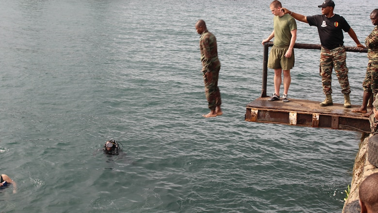 U.S. Marines and sailors are working with Cameroon's Fusiliers Marins and Compagnie des Palmeurs de Combat to increase their capabilities to combat illicit activity and increase security in the waterways and borders of Cameroon. At the request of the Cameroonian government and through coordination with the U.S. Embassy in Yaounde, Marines and sailors with Special-Purpose Marine Air-Ground Task Force Crisis Response-Africa, are partnering with their military counterparts in infantry tactics in support of their maritime security force capabilities.
