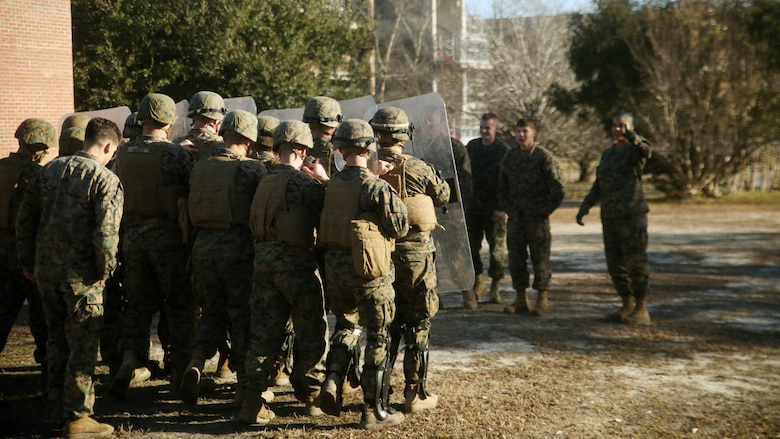 Marines with Combat Logistics Battalion 2 prepare to deescalate a crowd during non-lethal riot control training at  Marine Corps Base Camp Lejeune, N.C., Feb. 19, 2016. The focus of the training was to teach the Marines how to  deescalate situations without resorting to weapons that can injure or kill.