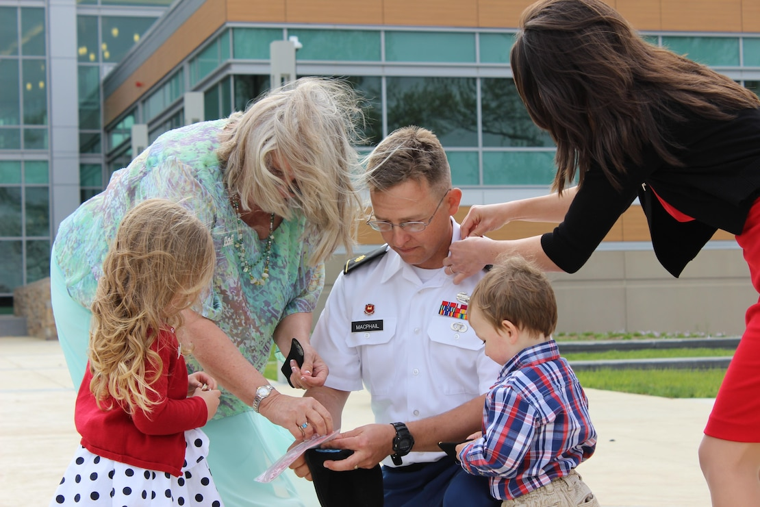 The family of now Maj. David MacPhail pin on his new rank insignia during his May 1, 2015, promotion ceremony. A career officer, he helped manage the construction of the U.S. Army Medical Research Institute for Chemical Defense at Aberdeen Proving Ground, Maryland, while serving with the U.S. Army Corps of Engineers, Baltimore District.