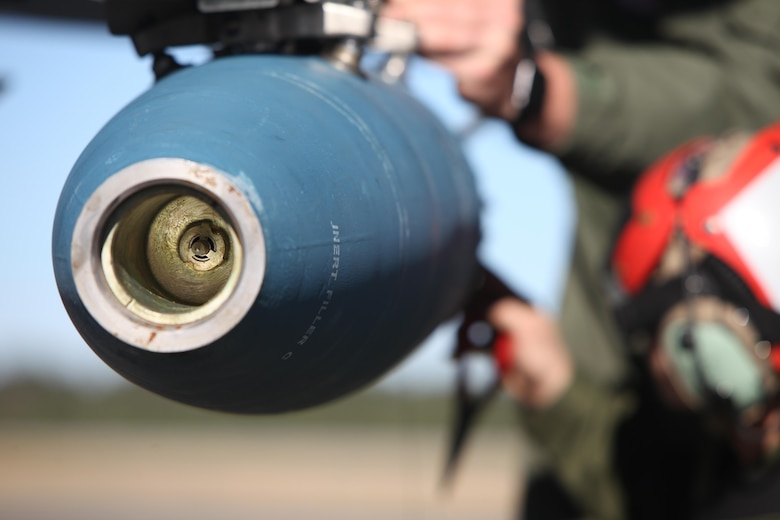 A BDU-45 practice bomb is inspected prior to a takeoff during Exercise Coastal Predator at Marine Corps Air Station Cherry Point, N.C., Feb. 16, 2016. The practice bomb falls according to the trajectory of the aircraft while in flight and is used for training purposes. Coastal Predator is an exercise that included Marine Corps and Army aviation assets along with Air Force personnel and civilian contractors to conduct Forward Air Controller Airborne training in accordance with the pre-deployment training program.  (U.S. Marine Corps photo by Cpl. Jason Jimenez/Released)