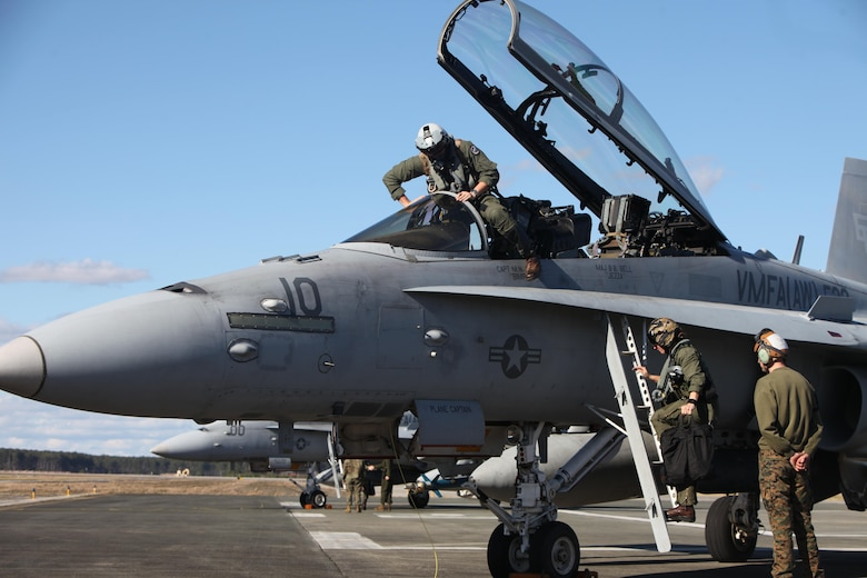 Pilots exit an F/A-18 Hornet to swap with a different crew during a hot loading procedure during Exercise Coastal Predator at Marine Corps Air Station Cherry Point, N.C., Feb. 16, 2016. Hot loading, aka hot rearming, is a reloading procedure completed while the aircraft's engine is still running, drastically reducing the time to get back in the fight. Coastal Predator is an exercise that included Marine Corps and Army aviation assets along with Air Force personnel and civilian contractors to conduct Forward Air Controller Airborne training in accordance with the pre-deployment training program.  (U.S. Marine Corps photo by Cpl. Jason Jimenez/Released)