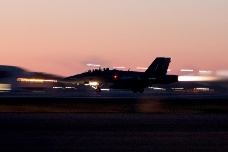 An F/A-18 Hornet accelerates prior to a takeoff during Exercise Coastal Predator at Marine Corps Air Station Cherry Point, N.C., Feb. 16, 2016. Coastal Predator is an exercise that included Marine Corps and Army aviation assets along with Air Force personnel and civilian contractors to conduct Forward Air Controller Airborne training in accordance with the pre-deployment training program.  (U.S. Marine Corps photo by Cpl. Jason Jimenez/Released)
