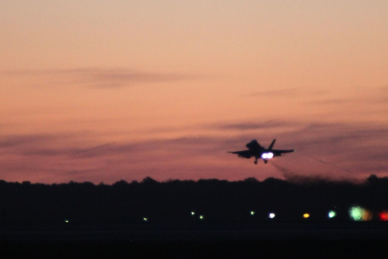An F/A-18 Hornet takes off during Exercise Coastal Predator at Marine Corps Air Station Cherry Point, N.C., Feb. 16, 2016. Coastal Predator is an exercise that included Marine Corps and Army aviation assets along with Air Force personnel and civilian contractors to conduct Forward Air Controller Airborne training in accordance with the pre-deployment training program.  (U.S. Marine Corps photo by Cpl. Jason Jimenez/Released)
