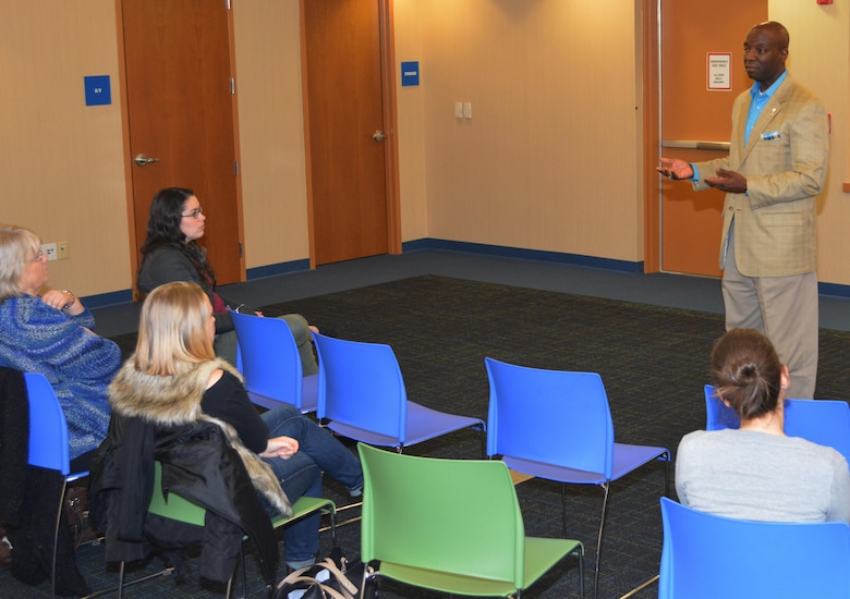 William Downey, the 80th Training Command Sexual Harassment/Assault Response and Prevention Program manager, discusses with advocates affiliated with The Regional Hospital Accompaniment Response Team the services available to military members who end up as sexual assault victims during a meeting at the Glen Allen Library.
