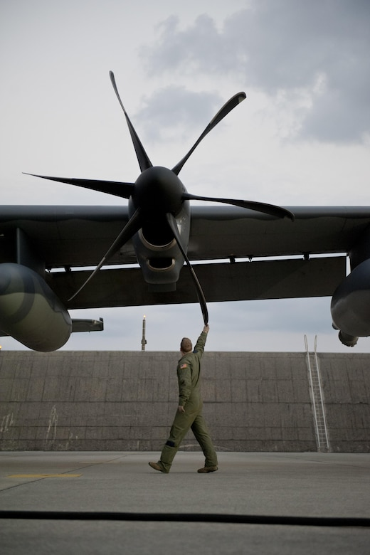 U.S. Air Force Senior Airman Tim Manzer, 17th Special Operations Squadron loadmaster, inspects an MC-130J Commando II prior to a sortie Feb. 17, 2016, at Kadena Air Base, Japan. Manzer participated in an aerial exercise involving a five-ship formation flight, cargo drops, short runway landings and takeoffs, and helicopter air-to-air refueling. (U.S. Air Force photo by Senior Airman Peter Reft/Released)