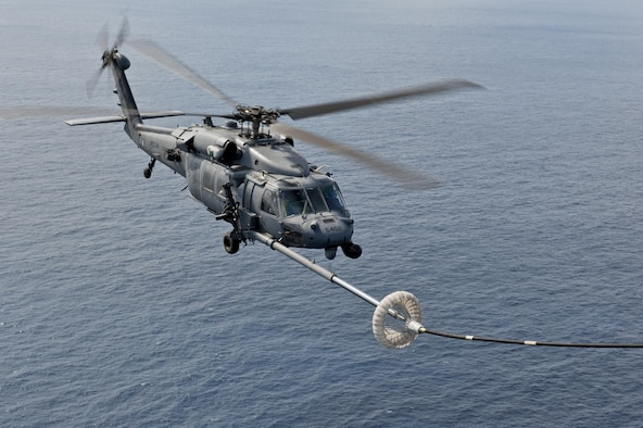 A U.S. Air Force HH-60G Pave Hawk helicopter assigned to the 33rd Rescue Squadron performs in-flight refueling during a training exercise Feb. 17, 2016, off the coast of Okinawa, Japan. The 33rd RS performs military personnel recovery, civil search and rescue, medical evacuation, disaster response, and humanitarian assistance. (U.S. Air Force photo by Senior Airman Peter Reft/Released)