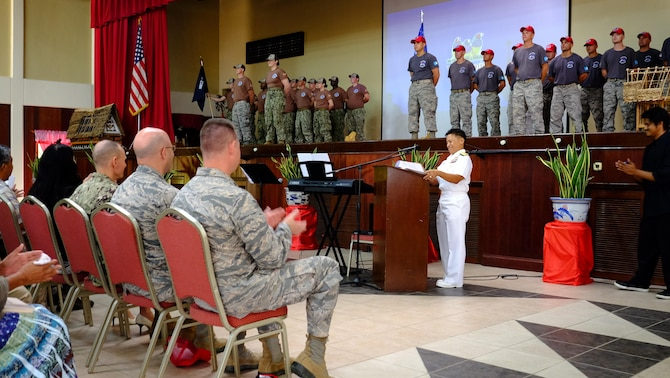 U.S. Navy Rear Adm. Bette Bolivar, Joint Region Marianas commander, speaks during a change of charge ceremony, held Feb. 19, 2016, at the Ngarachamayong Cultural Center, located in Palau's Koror state. Airmen of CAT 554-01 provided construction capabilities, apprenticeship training, medical outreach and community engagement opportunities while deployed to the Republic of Palau. (U.S. Air Force photo by Staff Sgt. Christopher Stoltz/Released)