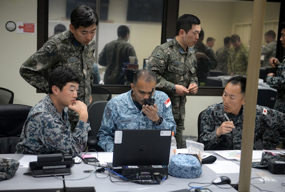 Airmen from the Japan Air Self-Defense Force, South Korean air force and Republic of Singapore Air Force participate in the command and control section of the final exercise of Partner Nation Silver Flag Feb. 19, 2016, at Andersen Air Force Base, Guam. The contingency environment training focused on bare-base bed down, sustainment operations and recovery after an attack. (U.S. Air Force photo/Senior Airman Joshua Smoot)
