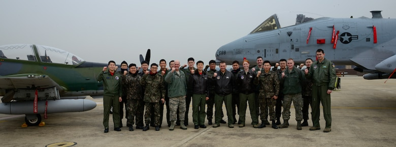 Personnel from the U.S. and Republic of Korea air forces pose for a group photo during Buddy Wing 16-2 on Osan Air Base, ROK, Feb. 22, 2016. The Buddy Wing exercise, conducted quarterly, is a combined program between the U.S. and ROKAF to promote solidarity and mutual understanding of all executed operations. (U.S. Air Force photo by Senior Airman Kristin High/Released)
