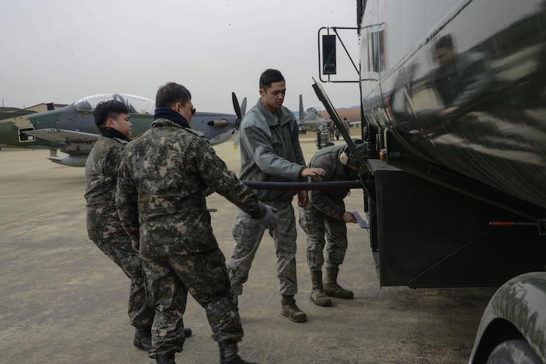 U.S. Air Force Airman 1st Class Christian Brancanto and Senior Airman Michael Campana, 51st Logistics Readiness Squadron fuels distribution operators, help Republic of Korea air force Master Sgts. Heo, Jae-bub and Yang, Hoon, 237th Aircraft Maintenance Unit crew chiefs, refuel their aircraft during Buddy Wing 16-2. The exercise provides an opportunity for the allied forces to train together and strengthen tactics in the event of real-world contingencies. (U.S. Air Force photo by Senior Airman Kristin High/Released)