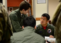 U.S. Air Force 1st Lt. Samantha Latch, 25th Fighter Squadron pilot, speaks with Republic of Korea air force Capt. Ahn, Hae-Chul, 237th FS pilot, during a pre-flight brief at Buddy Wing 16-2 on Osan Air Base, ROK, Feb. 23, 2016. Buddy Wing, the pilots coordinated mission planning for contingencies that may arise in the event of real world foreign aggression. (U.S. Air Force photo by Senior Airman Kristin High/Released)