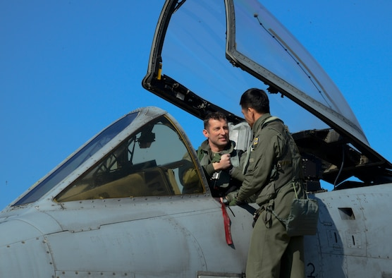 U.S. Air Force Maj. Jozsef Jonas, a 25th Fighter Squadron pilot, shakes hands with South Korean air force Capt. Ahn Hae-chul, a 237th FS pilot, before takeoff on Osan Air Base, South Korea, Feb. 24, 2016. Buddy Wing is conducted quarterly to sharpen interoperability between allied forces. (U.S. Air Force photo/Senior Airman Kristin High)