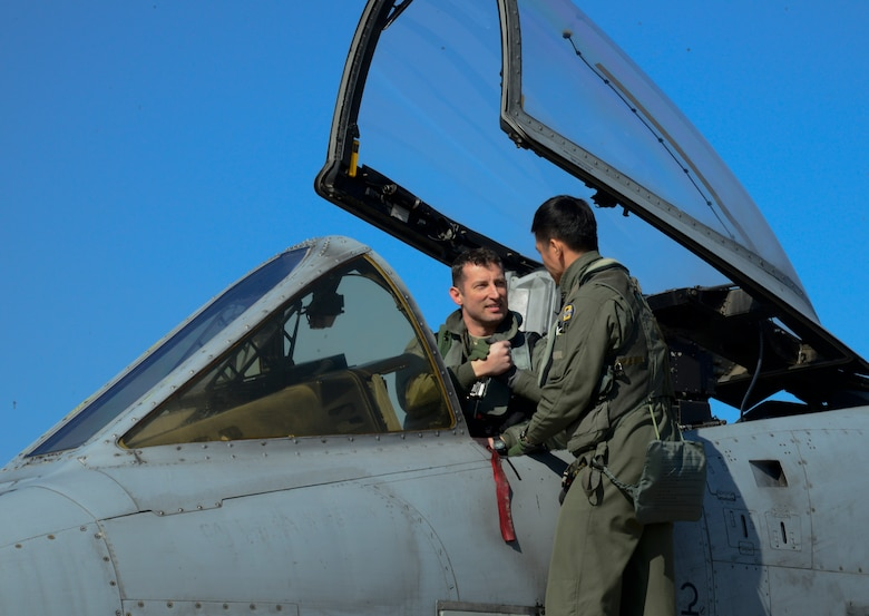 U.S. Air Force Maj. Jozsef Jonas, 25th Fighter Squadron pilot, shakes hands with Republic of Korea air force Capt. Ahn, Hae-Chul, 237th FS pilot, before take-off during Buddy Wing 16-2 on Osan Air Base, ROK, Feb. 24, 2016. Buddy Wing is conducted quarterly to sharpen interoperability between allied forces. (U.S. Air Force photo by Senior Airman Kristin High/Released)