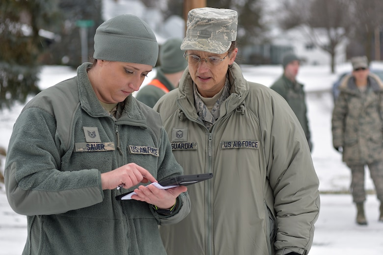 Tech Sgt. Jennifer Sauer and Master Sgt. C.K. Laguardia, both members of the Michigan Air National Guard, review the day's operations during water delivery efforts in Flint, Mich., Jan. 21, 2016. Selfridge Air National Guard Base has served as a hub for water distribution efforts in Flint. Sauer is assigned to the 127th Wing at Selfridge. Laguardia is a member of the 110th Attack Wing in Battle Creek. (U.S. Air National Guard photo)