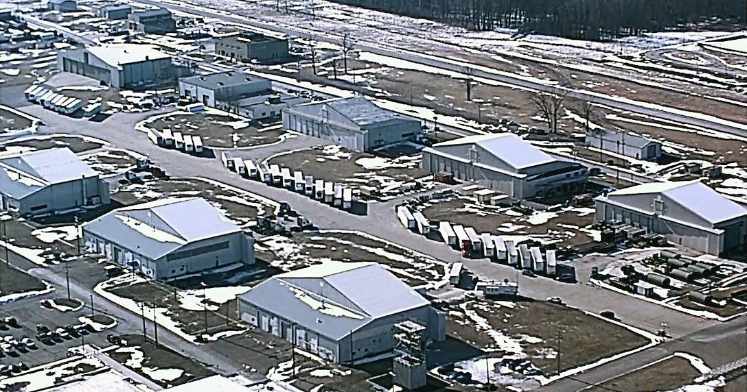 This aerial photo shows truck trailers at Selfridge Air National Guard Base, staged for delivery to Flint, Mich., during water delivery efforts there. The Federal Emergency Management Agency and the Michigan National Guard are working closely together, along with other city and state agencies, to supply bottled water and water filters to Flint residents. (U.S. Air National Guard photo)