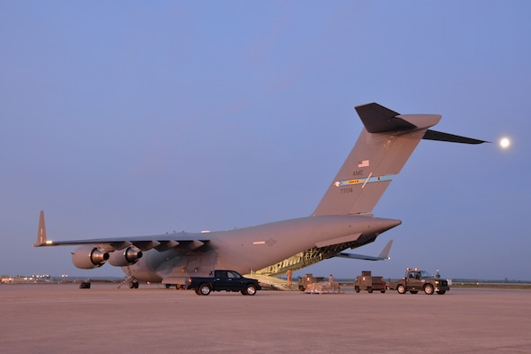 The moon hangs over Airmen unloading vehicles and equipment from a C-17 Globemaster III at Morón Air Base, Spain, Feb. 24, 2016. The cargo was delivered in support of Exercise Cold Response 16, a Norwegian-led NATO exercise designed to give allied militaries a chance to collectively develop tactics, techniques, and procedures and increase interoperability. (U.S. Air Force photo/Senior Airman Joseph Raatz)