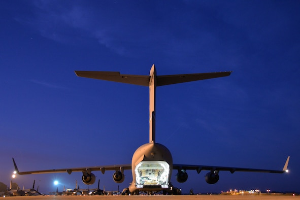 A C-17 Globemaster III lowers its cargo ramp while waiting to be unloaded at Morón Air Base, Spain, Feb. 24, 2016. The cargo was flown to Spain in preparation for Exercise Cold Response 16, a biennial NATO exercise involving nearly 16,000 troops from a dozen allied and partner nations. (U.S. Air Force photo/Senior Airman Joseph Raatz)